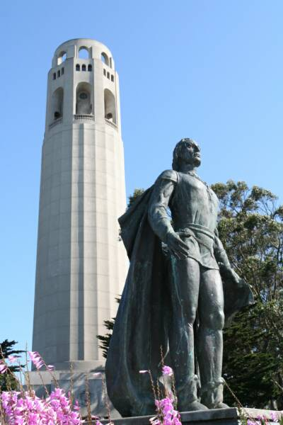 a statue right beside coit tower